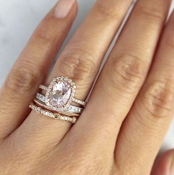 Beautiful rose gold accented engagement ring paired with multiple thin rose gold bands | Trabert Goldsmiths/Instagram