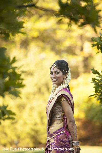 South Indian bride. Temple jewelry. Jhumkis.Purple silk kanchipuram sari.Braid with fresh flowers. Tamil bride. Telugu bride. Kannada bride. Hindu bride. Malayalee bride.Kerala bride.