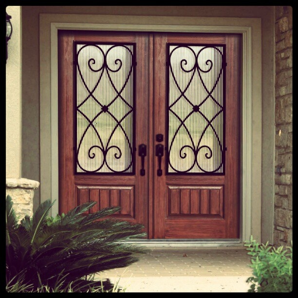 Elegant Fiberglass Entry Doors with Wrought Iron