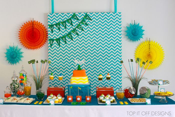 Vendor Credits:  Event Styling & Photography: Valerie Cianci for Top It Off Designs  Bamboo Spork, Polkadot Candy Cups, Paper Straws & Tissue Fans: Shop Sweet Lulu  Fondant Cupcake Toppers: Edible Details  Mini Cake Bunting, Glittered Glassine Bags & Mini Flags: The Purple Pug  Cake & Dino Cookies: Katicake World