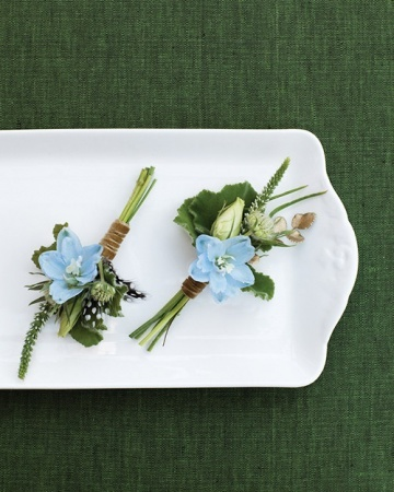 Light-blue delphinium, lisianthus buds, geranium foliage, veronica tips, and button ferns