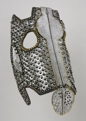 Head defense for a horse.  Tibetan or Mongolian.  15th-17th century.  Iron, leather, brass or copper alloy.