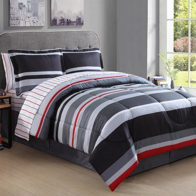 The Mi Zone Kyle comforter set provides a stylish update to your boy's room. The printed deep red and blue stripes work perfectly against the bright white and heather grey in this collection. One decorative pillow pulls the top of bed colors together along with twill tape to complete this look.