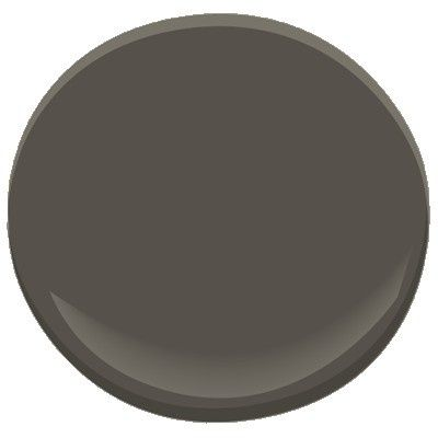 benjamin moore dragon's breath 1547. Good color for a fence, dark gray with a touch of brown, a perfect backdrop for plants.