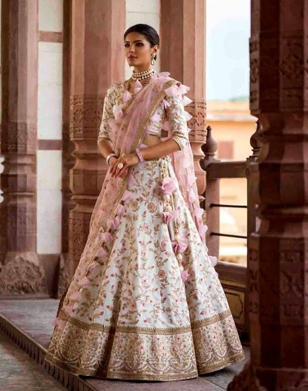 93bcd8a22ed1 Beautiful Hand+Machine embroidered Lehenga-Choli. Embellished with ruffled  dupatta.