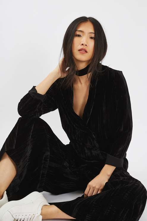 Invest in a chic wardrobe piece with this black velvet blazer in crinkle material. A double breasted style, it comes in a long-line fit and can be worn bare-legged as a dress or with wide-leg trousers or a printed skirt. #Topshop