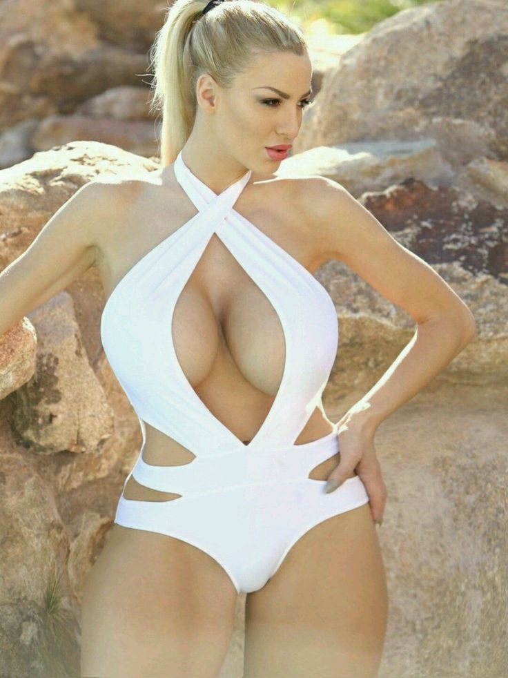 Busty Blonde In A Beautiful One Piece Costume