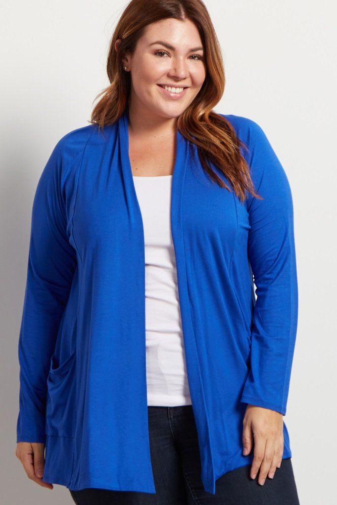 A solid plus size cardigan. Long sleeve. Front pockets. Open