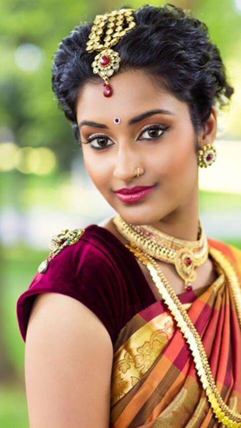Indian bride wearing bridal jewellery and makeup. #CurlyHair