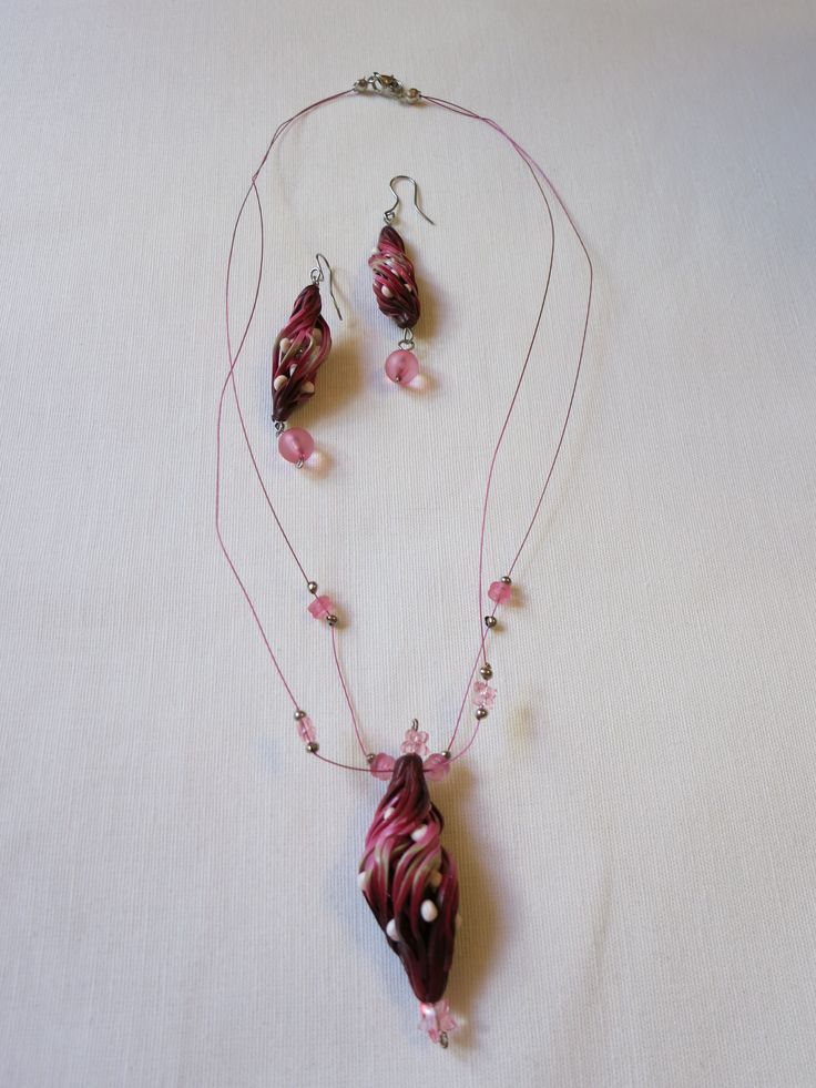Hand made polymer clay necklace and earrings.   https://www.facebook.com/Anna-Donna-%C3%A9kszer-231340573715505/