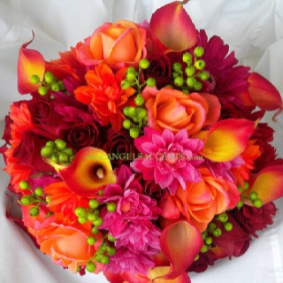 Callas Lillies, Roses, Gerbras and Chrysanthamums  Mixing hot pink with orange can be a job, but this one I love.