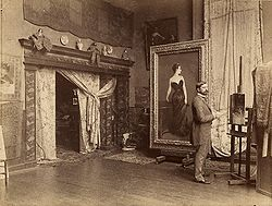 This is the painter John Singer Sargent in his Paris Studio (round 1885) with the Portrait of Madam X painting