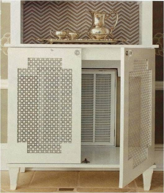 Hide the Air Vent: There is a large return air vent behind this cabinet. The cabinet was painted, wallpaper added on the back of the top shelf part, and the bottom of the back is cut out, and with doors covered in decorative metal mesh you can get at Home Depot or Lowes. the sister sophisticate blog