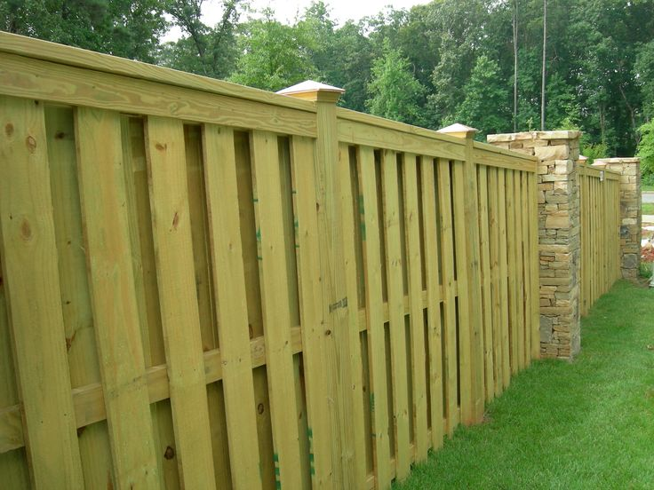 Shadow Box Fence with trimmed top. I am completely in love with this fence. Would like to have this without the brick to reduce costs!