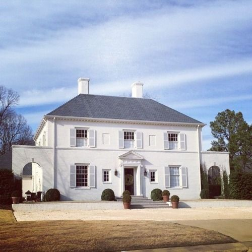 I love this house in English Village! Simplicity is beauty in this white-on-white, symmetrical home in...