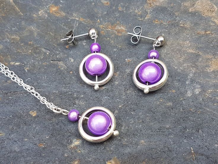 Lilac miracle beads in frames.