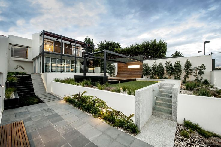 Originally too steep to be usable, this sloping section has been transformed into a contemporary landscape with terraces and plenty of visual interest