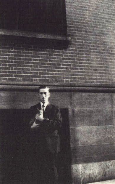 HP Lovecraft and a feline companion.