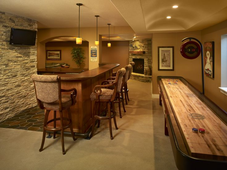 Rustic Style Of Basement Remodeling Idea With Wood Bar And Classic  Barstools And Antique Bar Floor Tile Also Mini Pendant Lights And TV  Mounted On Exposed ...