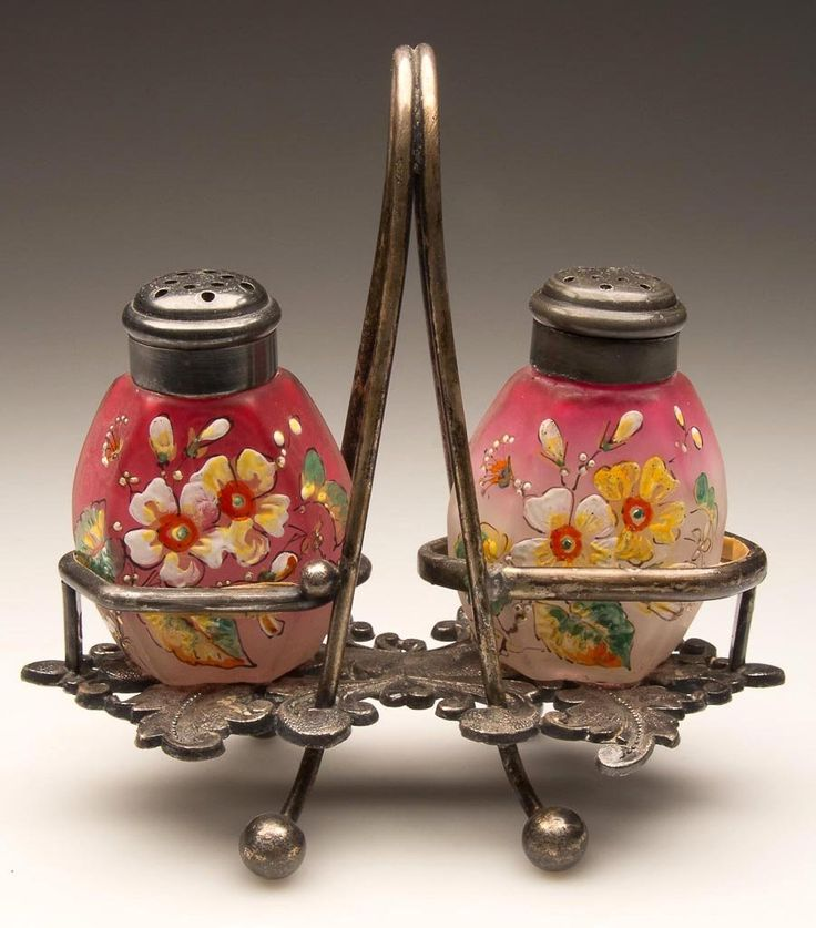 HEXAGLORY PAIR OF SALT AND PEPPER SHAKERS, rubina with satin finish and bright polychrome floral decoration, matching period two-part lids. Fitted in a quadruple-plate stand marked for the Meriden Britannia Co. and numbered 74. Fourth quarter 19th century.