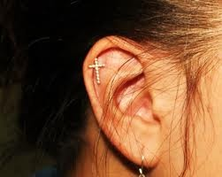 I'd like to get my cartilage pierced now please:) then get a cross like this and a starfish;)