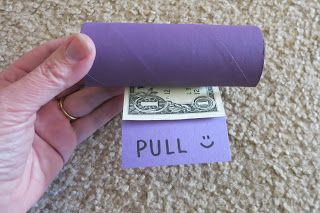 Fun way to give money as a gift. Line up dollar bills end to end. Tape each bill together then roll up.  Insert in an empty (painted) toilet paper roll with a notch cut out. Directions and additional photos on blog. Super cute idea from Cindy deRosier.