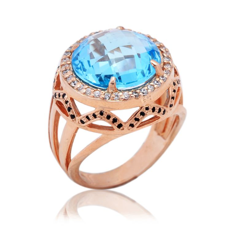 Blue Topaz with white and black diamonds in sterling silver with rose gold.