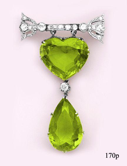 Art Deco. Platinum, Peridot and Diamond Brooch.