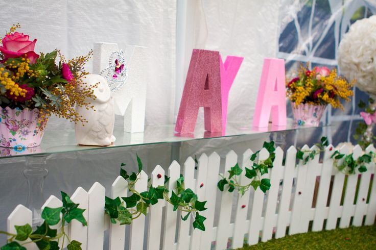Ombre letters, picket fence, vines, synthetic grass & ladybugs - Garden party table setting (cake table/dessert table/lolly bar) for my daughter Maya's first birthday (styled by Leah Bischoff)