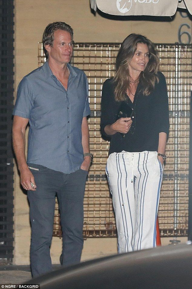 Time to celebrate: Cindy Crawford and husband Rande Gerber  had extra reason to push the b...