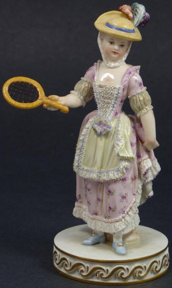Antique Meissen German porcelain figure. Depicts a woman playing tennis or badminton, 19th century