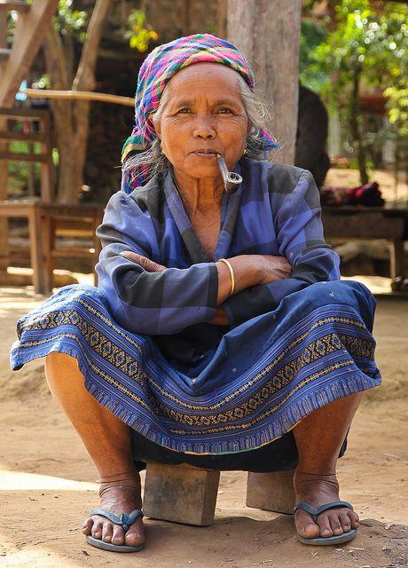 Hmong woman smoking pipe in her village near Luang Namtha, Laos, December 2012 (by Freek Nijenhuis)