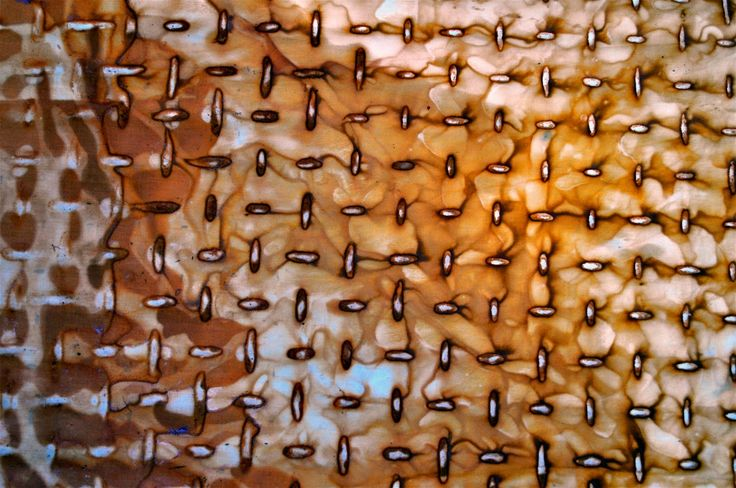 LuAnn Kessi: 2 yard piece of fabric stained by rusted culvert screen. Back side of fabric
