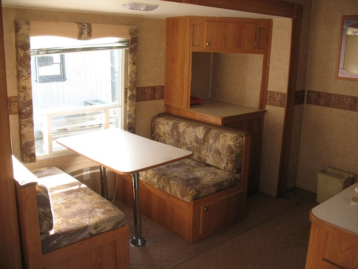 BEFORE: Living Area Slide With Dinette And Corner Cabinet. Travel Trailer  RemodelCorner Cabinets
