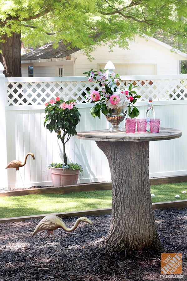 Bar height tree stump table, gold flamingos, and a mini bocce ball court – what more do you need?!