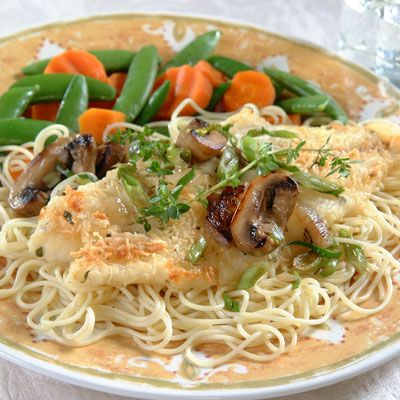 Tasty baked Parmesan fish fillets  are served over angel hair  pasta, and covered with a delicious mushroom and onion medley. Use chopped or crushed fresh thyme as a garnish to deliver a delightful aroma and  extra visual appeal.
