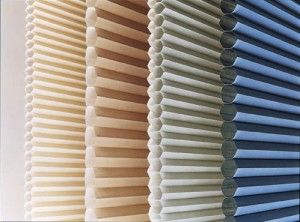 Honeycomb blinds  - @Kelley Murphy they fold up to about an inch as they are made of a sort of rice paper