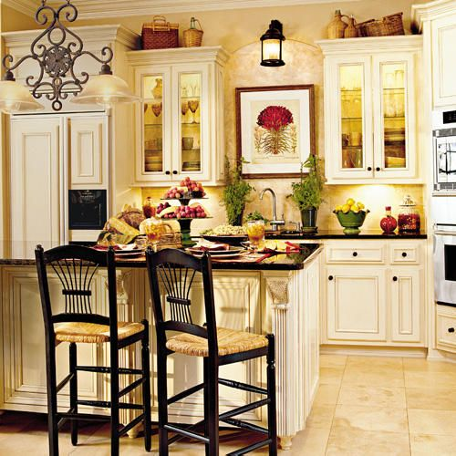 Classic Comfort Kitchen ... the touch of black.....nice contrast Google Image Result for http://img4.southernliving.com/i/2004/02/classic-comfort/williams-kitchen-x.jpg%3F500:500