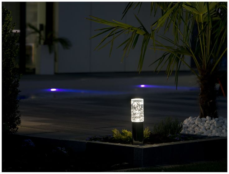 Exterior LED lamp made of stainless steel and hand blown glass.