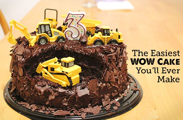 construction cakeTo assemble, simply cut a chunk out of the cake and arrange the construction vehicles on it to appear as though they're working on it – dig down with the shovels, plunge in with the fork lifts, etc.  If you're not looking to surprise your little one, it's fun to let them help set up the scene.