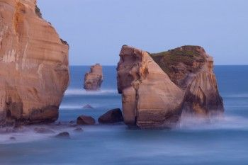 Dusk at Tunnel Beach in Dunedin, New Zealand. - Print available for purchase, prices begin at $49.