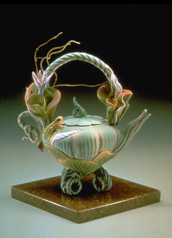 """Jade Lily Tea, Nancy Adams 9"""" H x 8"""" W Wheel-thrown vessel with hand-rolled base and hand-carved lotus and frog motifs. Air-brushed glazes. $900"""