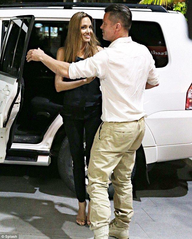 MALNOURISHED! Opening the door for his lady: Brad Pitt was a gentleman and let Angelina Jolie out of the car as they arrived at the Shipwrecked Seafood Ba...