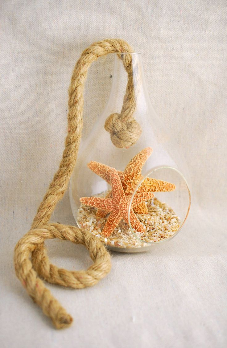 Nautical glass terrarium filled with sugar starfish and shells...for beach wedding welcome table or gift table decorations.