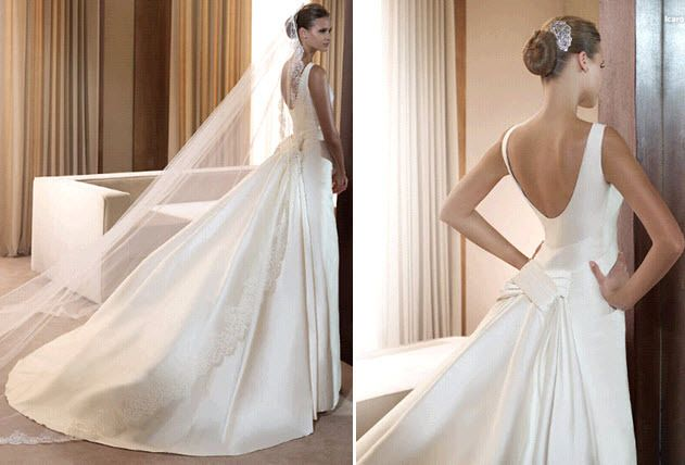 Classic white simple structured wedding dress by Pronovias with low scoop back