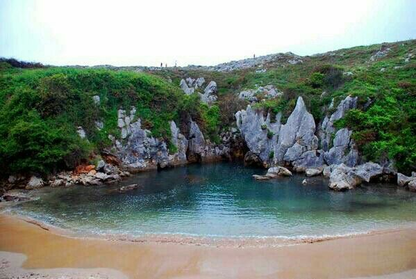 Gulpiyuri beach (Llanes coast, Asturias, Spain) Shaped as a half circle separated from the sea by the shelvings, it is a place where one can bathe without seeing the sea.