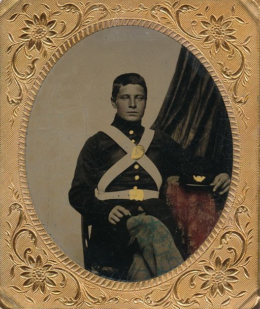 """Extremely rare sixth plate tintype of a war date US Marine. The number of US Marines during the war never exceeded 3800 men. He wears his enlisted undress uniform with sky blue trousers worn only during the winter months with white trousers worn during the summer. The white buff cross belts issued to enlisted Marines had unadorned oval breast plate, likewise the waist belt.  His kepi with the brass infantry horn would have had an """"M"""" in the center of the horn but it is gilded over here."""
