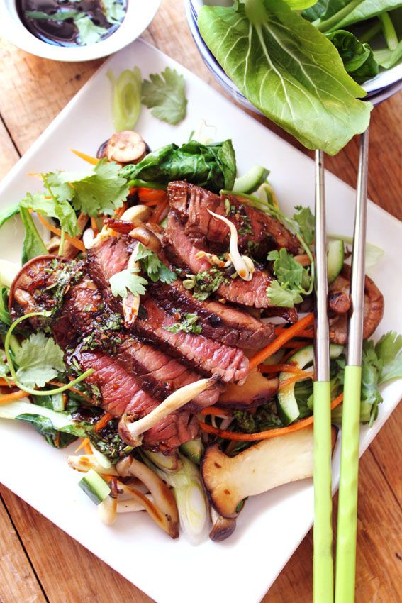 A recipe for Asian Steak Salad featuring rare, tender steak in an Asian flavoured marinade on a bed of greens