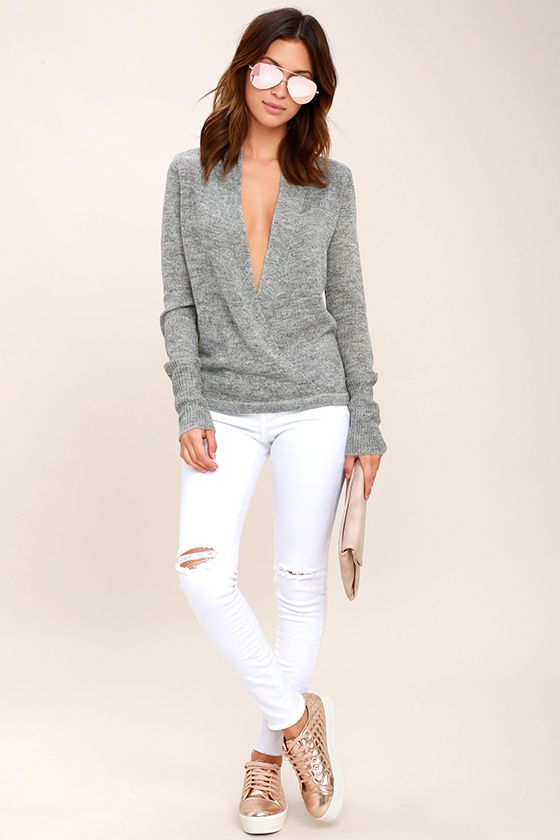 Show off your new lace bralette or drop necklace in the Warm Me Up Heather Grey Wrap Sweater Top! This soft and lightweight sweater has a plunging, surplice bodice, long sleeves, and slightly cropped hem.