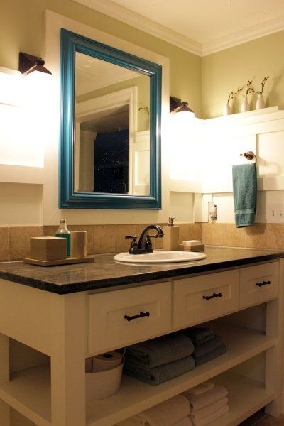 Basement-Bathroom-Small mirror with white wooden frame around